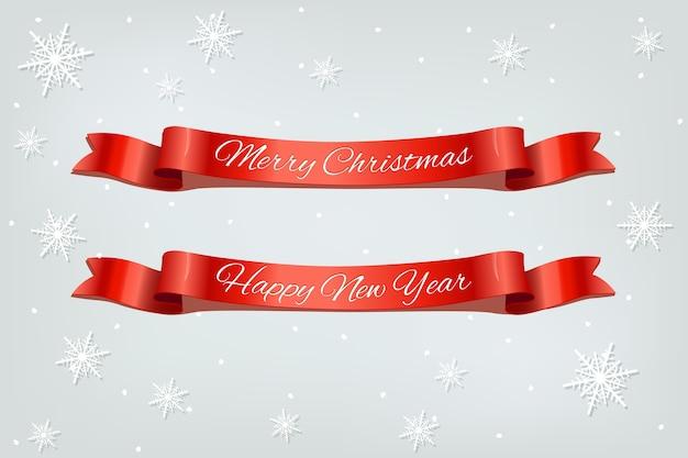 Wesołych świąt i szczęśliwego nowego roku czerwone wstążki realistyczne