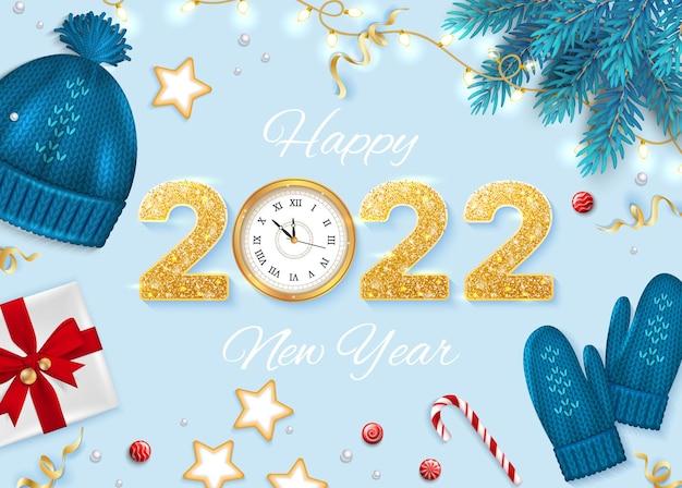 Wesołych świąt i szczęśliwego nowego roku kartkę z życzeniami elementy zimowe gałęzie jodły z dzianiny niebieski kapelusz