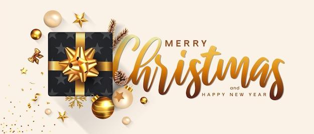 Wesołych świąt i szczęśliwego nowego roku kartkę z życzeniami. projekt świąteczny udekoruj pudełkiem, złotymi kulkami, butelką wina i gwiazdą na jasnym tle.