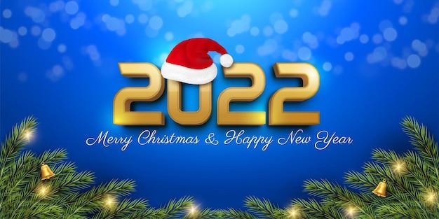 Wesołych świąt i szczęśliwego nowego roku na niebieskim tle z elementami dekoracji świątecznych