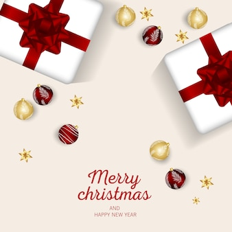 Wesołych świąt i szczęśliwego nowego roku powitanie na czerwono z świątecznymi bombkami i prezentami.