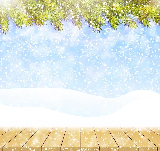 Wesołych świąt i szczęśliwego nowego roku powitanie tło z drewnianym blatem. zimowy krajobraz ze śniegiem i choinkami