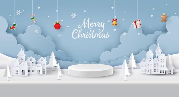 Wesołych świąt i szczęśliwego nowego roku, puste podium w kształcie cylindra w środku wiejskiej wioski w zimie, papierowy kolaż i styl wycinany z papieru z cyfrowym rękodziełem. puste podium w kształcie cylindra pośrodku