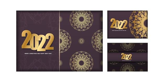 Wesołych świąt i szczęśliwego nowego roku szablon ulotki w kolorze bordowym 2022 ze złotym ornamentem w stylu vintage