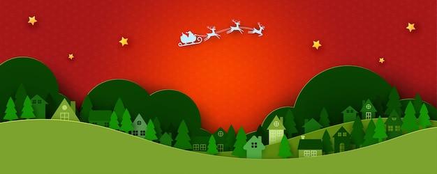 Wesołych świąt i szczęśliwego nowego roku tło krajobraz sezonu zimowego, święty mikołaj w saniach i miejskiej wsi sztuka z papieru