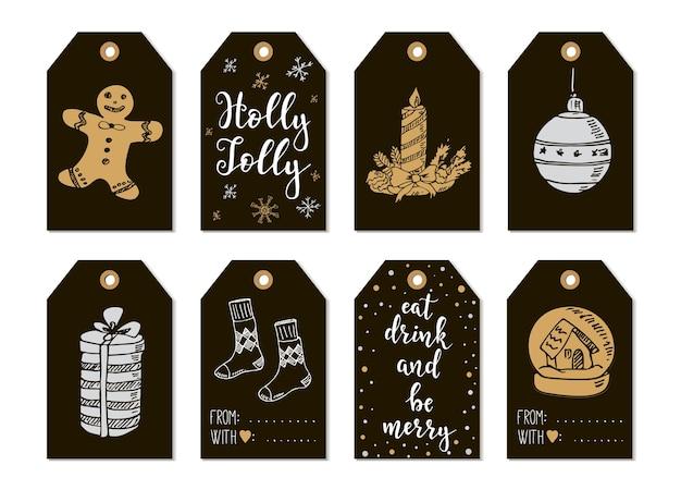 Wesołych świąt i szczęśliwego nowego roku vintage prezentowe tagi z kaligrafią. napis odręczny. ręcznie rysowane elementy projektu. przedmioty do druku