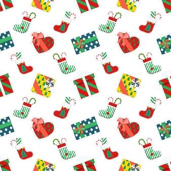 Wesołych świąt i szczęśliwego nowego roku wzór z prezentami. papier pakowy ferii zimowych. tło