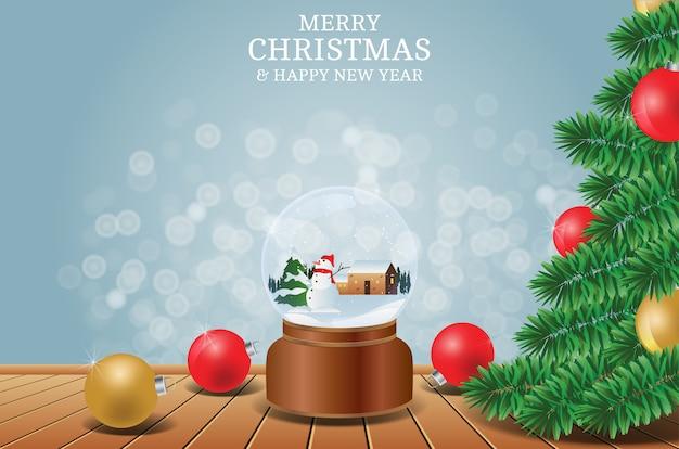 Wesołych świąt i szczęśliwego nowego roku z tłem kryształowej kuli drzewa i bałwana