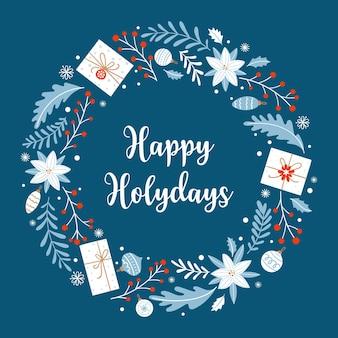 Wesołych świąt. kartka świąteczna z prezentami, kwiatami poinsecji i innymi ozdób choinkowych na niebieskim tle. okrągły wieniec w stylu skandynawskim.