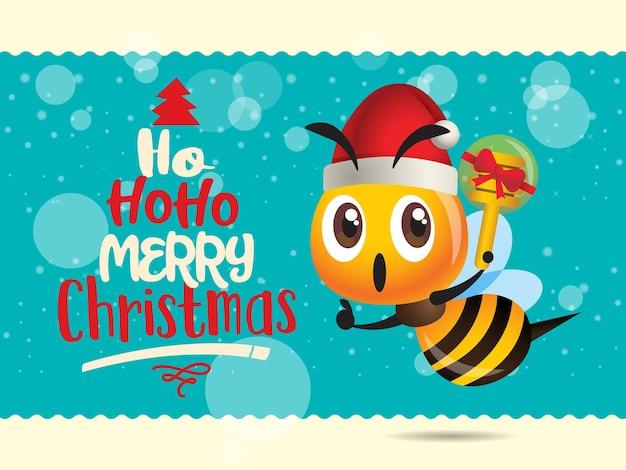 Wesołych świąt kreskówka śliczna pszczoła trzyma prezent z miodem z życzeniami świątecznymi