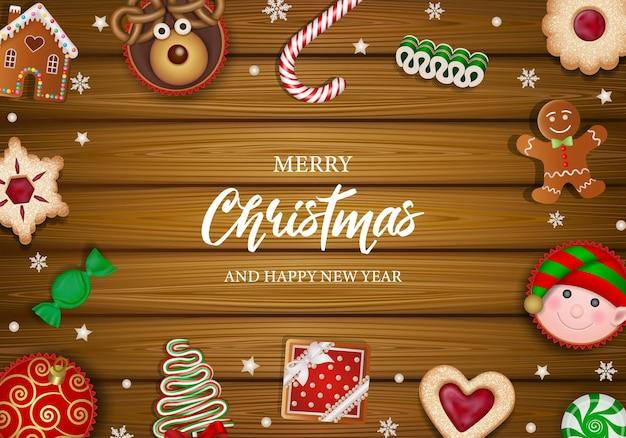 Wesołych świąt plakat z ciasteczkami, cukierkami i ciastami na drewnianym tle