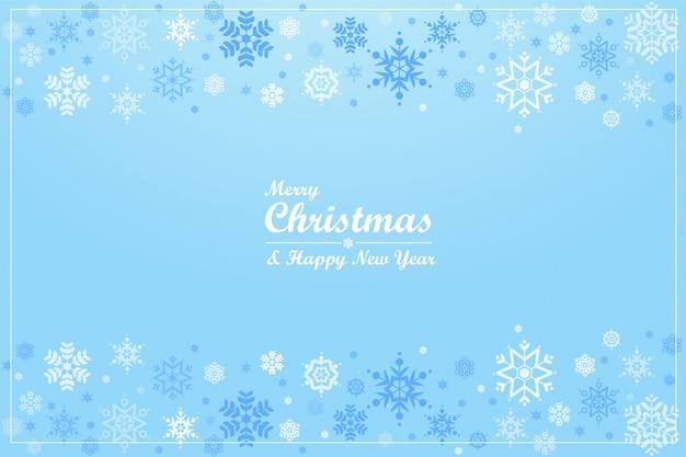 Wesołych świąt. śliczni płatki śniegu na błękitnym tle.