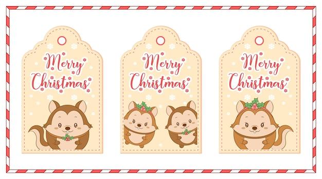 Wesołych świąt słodkie wiewiórki z kartami z tagami rysowania płatka śniegu