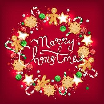 Wesołych świąt wianek ze słodyczy, ciastek, lizaków, cukierków, cukierków, światełek z piernika