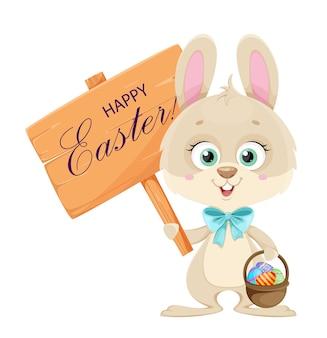 Wesołych świąt wielkanocnych. ładny mały króliczek trzyma drewniany znak z pozdrowieniami