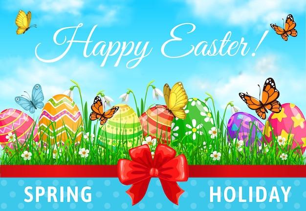 Wesołych świąt wielkanocnych, pisanki na źdźbłach trawy z wiosennymi kwiatami