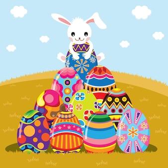 Wesołych świąt wielkanocnych z cute bunny na wierzchu malowane jajka