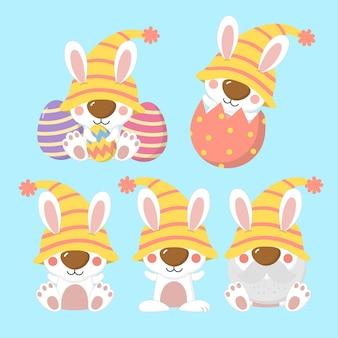 Wesołych świąt wielkanocnych z jajkami i króliczkiem w stroju krasnali.