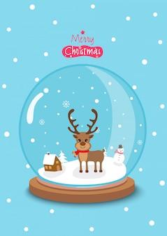 Wesołych świąt z kulą świata ozdobioną reniferem i śniegiem na niebiesko