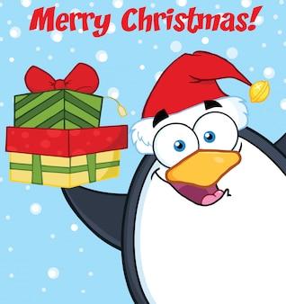 Wesołych świąt z pingwinem cartoon maskotka trzyma się stos prezentów