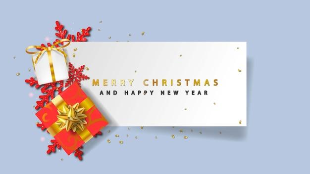 Wesołych świąt z pudełkiem prezentowym 3d, płatkiem śniegu i tekstem na papierze