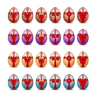 Wesołych świąt zestaw malowanych pisanek z czerwonymi kokardkami i wstążkami z koronki oraz kamieniami szlachetnymi