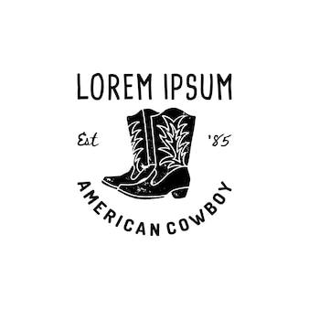 Western logo amerykańskie buty kowbojskie ręcznie rysować styl grunge. symbol dzikiego zachodu śpiewają o kowbojskich butach i retro typografii. vintage godło do druku, plakatu, koszulki, okładki, banera lub innej firmy
