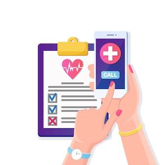 Wezwać lekarza, pogotowie. ludzką ręką trzymać telefon komórkowy z krzyżem na ekranie. dokument ubezpieczenia zdrowotnego z czerwonym sercem, umowa lekarska. raport diagnostyczny z kliniki.