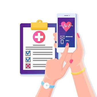 Wezwać lekarza, pogotowie. ręka trzymać telefon komórkowy z czerwonym sercem, linia bicia serca, kardiogram na ekranie. dokument ubezpieczenia zdrowotnego z krzyżykiem, umowa lekarska raport diagnostyczny kliniki