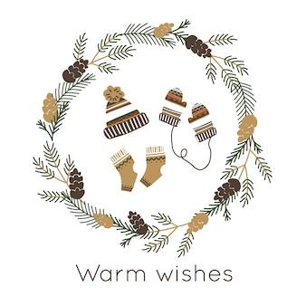 Wianek świąteczny z ciepłymi skarpetkami, rękawiczkami i dzianinową czapką