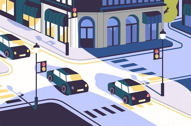 Widok na miasto z samochodami jadącymi wzdłuż drogi, nowoczesne budynki, skrzyżowanie ze światłami i przejścia dla pieszych