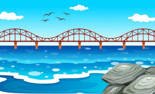 Widok na ocean z mostem