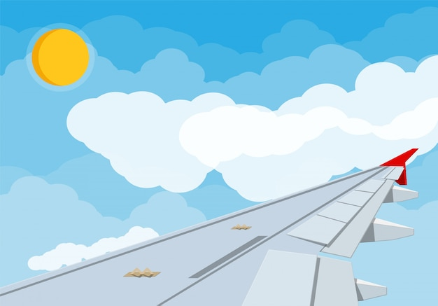 Widok skrzydło samolot w niebie.