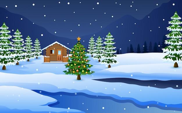 Widok śnieżna drewniana domu i choinki dekoracja