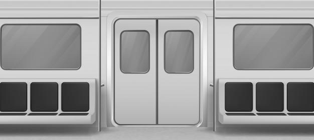 Widok wnętrza wagonu metra z drzwiami, siedzeniami
