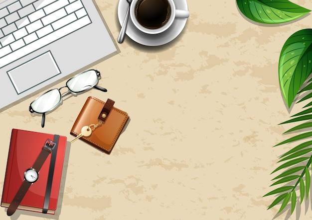 Widok z góry biurowy stół roboczy z elementami biurowymi z zielonymi liśćmi