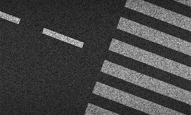 Widok z góry na asfalt i przejście dla pieszych. bezpieczeństwo podczas jazdy i ruchu.