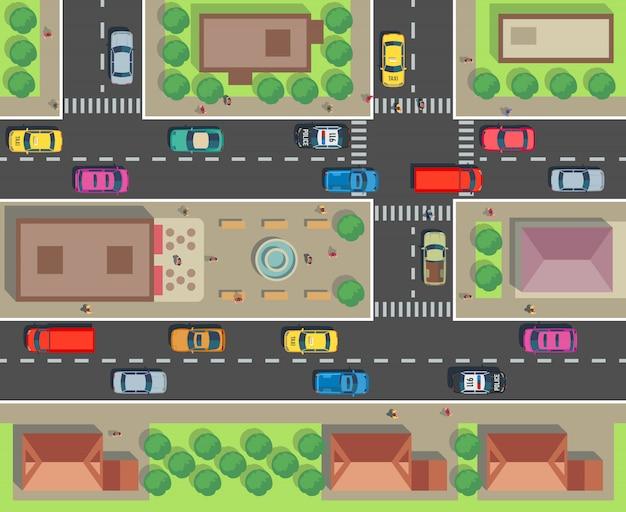 Widok z góry na miasto. budynek i ulica z samochodami i ciężarówkami. mapa ruchu miejskiego