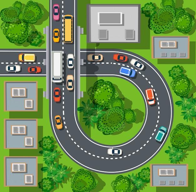 Widok z góry na miasto z ulic, dróg, domów i samochodów