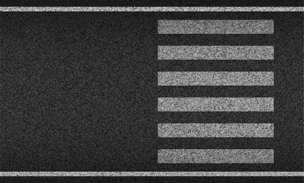 Widok z góry na przejście dla pieszych z teksturowanym asfaltem. bezpieczeństwo podczas jazdy i ruchu.