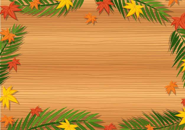 Widok z góry na pusty drewniany stół z liśćmi w elementach różnych sezonów