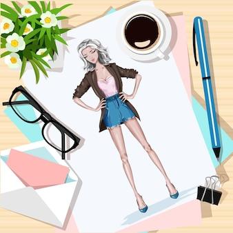 Widok z góry na stół z kwiatami, papierami, szkicem, długopisem, kopertą i filiżanką kawy.