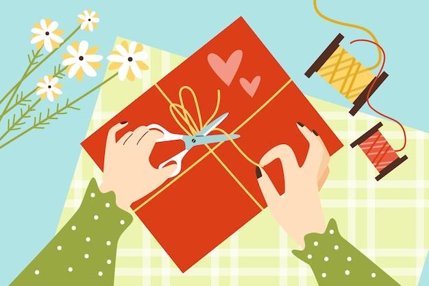Widok z góry na stole z kobiecymi rękami, pakowanie ilustracji wektorowych płaski prezent