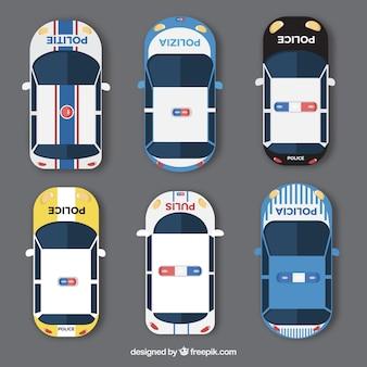 Widok z góry na sześć samochodów policyjnych z różnych krajów