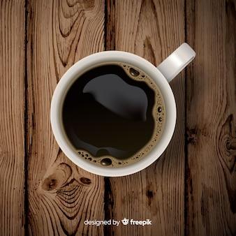Widok z góry o filiżankę kawy z realistycznym wystrojem