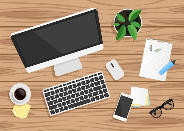 Widok z góry pracy biznesowej na biurko z drewna