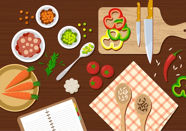 Widok z góry stołu kuchennego z warzywami i przyborami kuchennymi