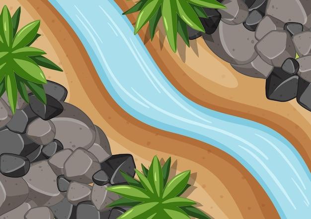 Widok z lotu ptaka na rzekę z bliska z elementem lasu
