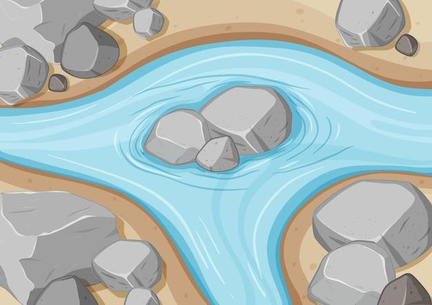 Widok z lotu ptaka na rzekę z bliska z kamiennym elementem