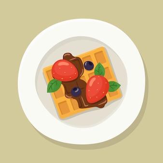 Wiedeńskie gofry na talerzu z truskawkami, jagodami i czekoladą